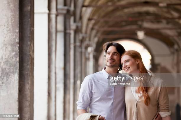 Smiling couple in corridor in Venice