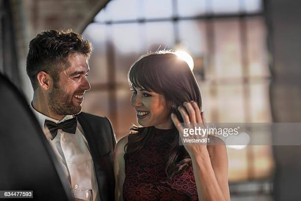 smiling couple in elegant clothing - evening gown stock pictures, royalty-free photos & images