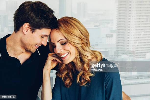 smiling couple in love - older woman younger man stock photos and pictures