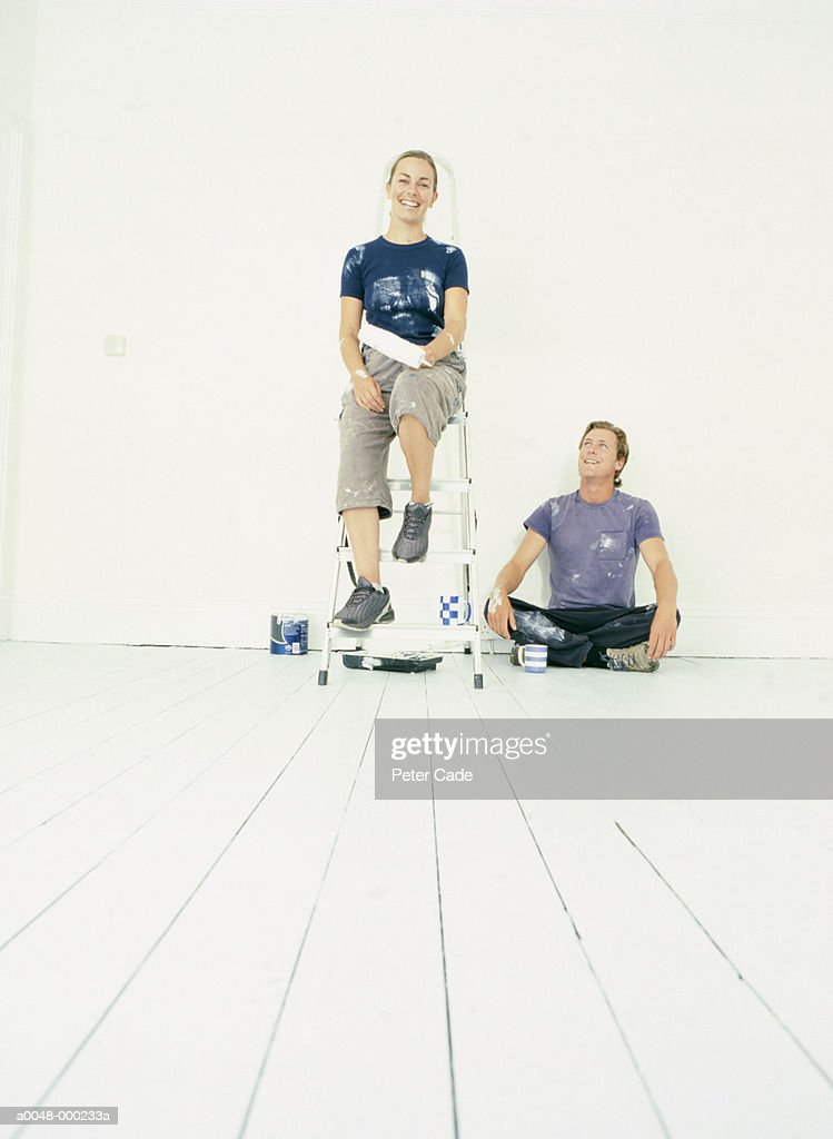 Smiling Couple in Painted Room : Stock Photo