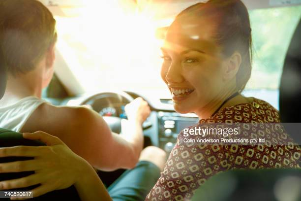 Smiling couple in sunny car