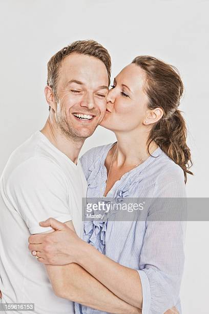 Smiling couple kissing