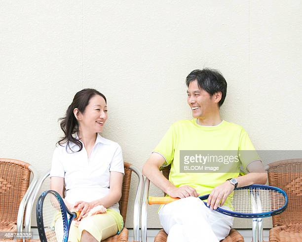 smiling couple looking at each other - 中年カップル ストックフォトと画像