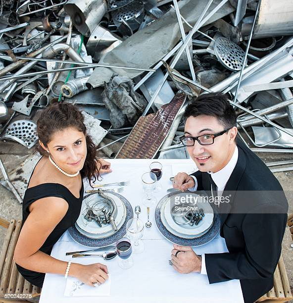 Smiling Couple Lunching in Landfill