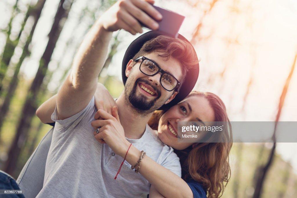 Smiling couple making selfie : Stock Photo