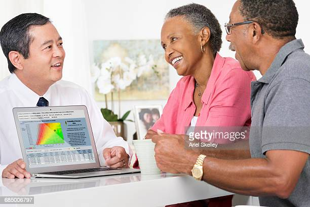Smiling couple meeting with financial advisor