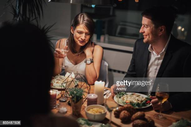 Smiling couple on a double date with friends.