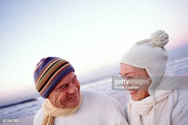 Smiling couple on a wintry beach