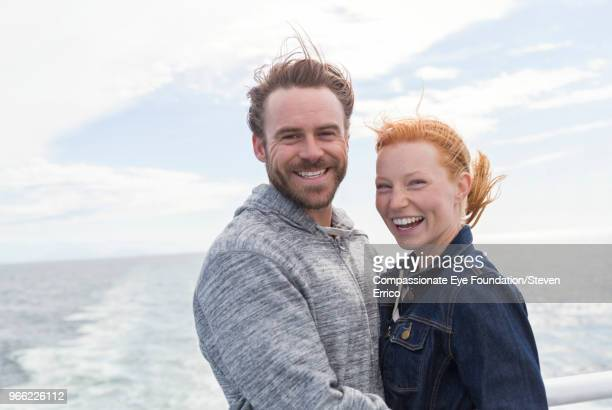 Smiling couple on boat deck
