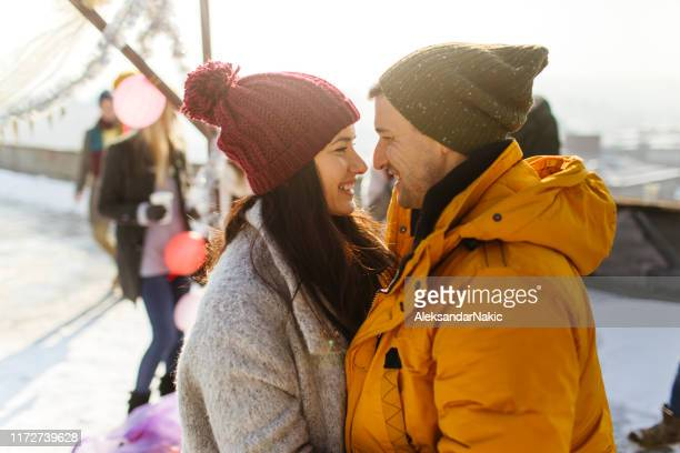 smiling couple on new year's day - warm clothing stock pictures, royalty-free photos & images