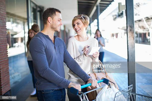 Smiling couple on shopping tour