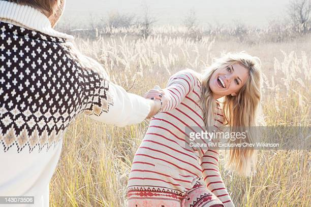 Smiling couple playing in field