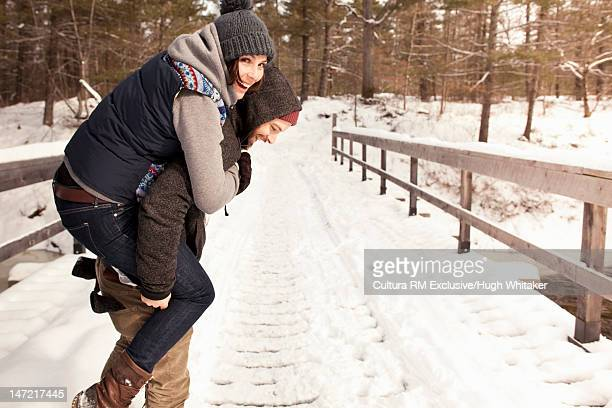 Smiling couple playing in snow