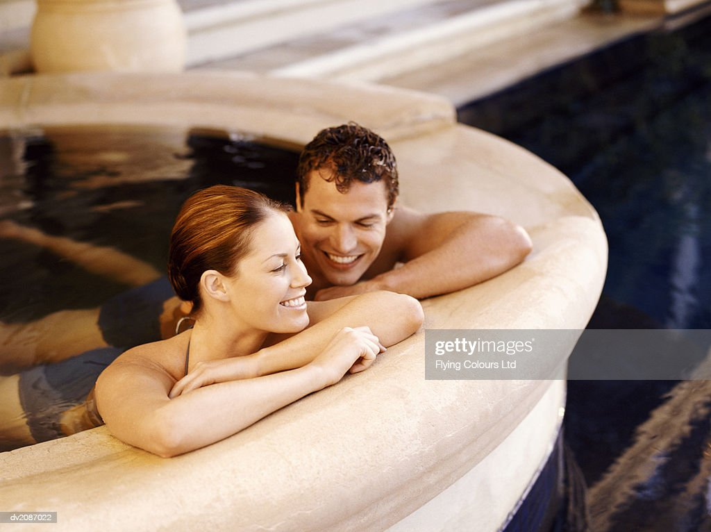Smiling Couple Relaxing in a Bathhouse : Stock Photo