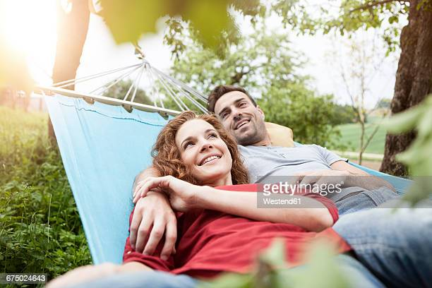 Smiling couple relaxing in hammock