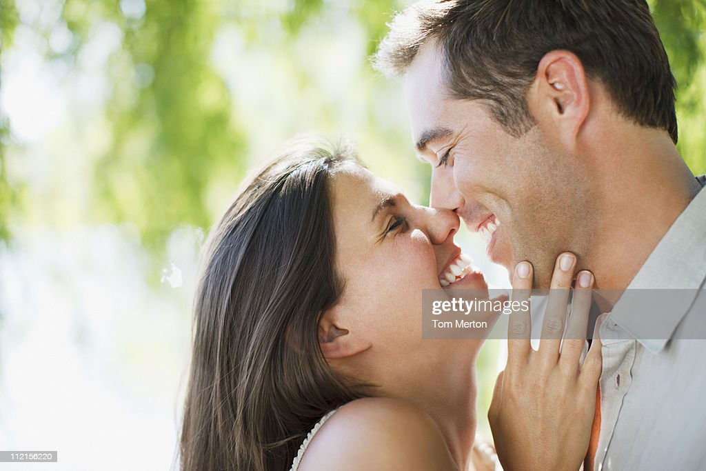 Smiling couple rubbing noses outdoors : Stockfoto