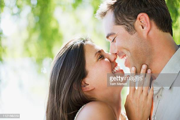 Smiling couple rubbing noses outdoors
