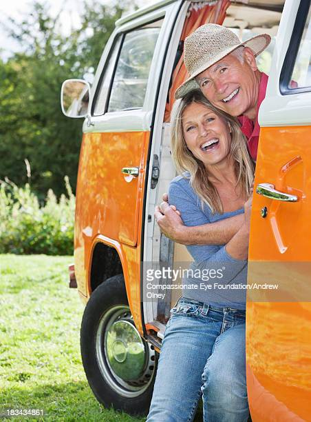 smiling couple sitting in camper van - cef do not delete stock pictures, royalty-free photos & images