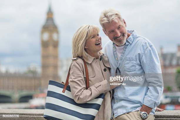 Smiling couple standing against Big Ben