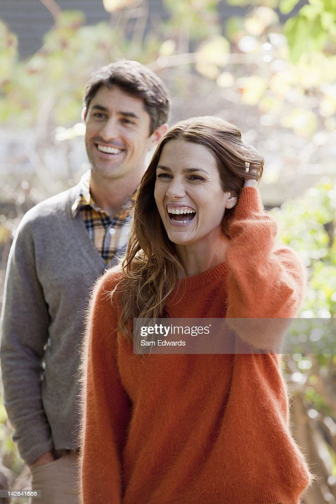 Smiling couple standing outdoors : Photo