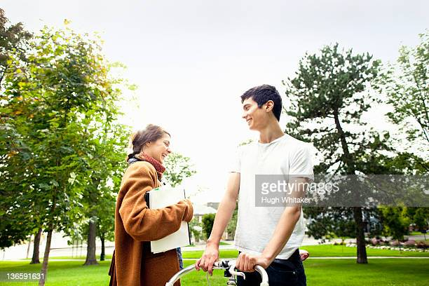 smiling couple talking in park - peterborough ontario stock photos and pictures