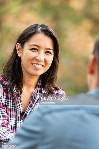 smiling couple talking - 中年カップル ストックフォトと画像