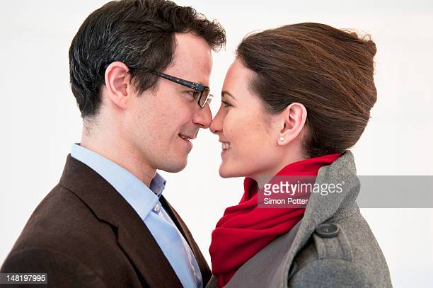 smiling couple touching noses - 148197995 stock photos and pictures