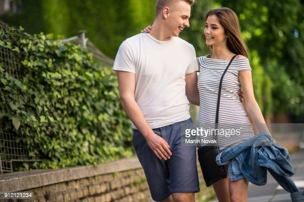 Smiling couple with arms around each other