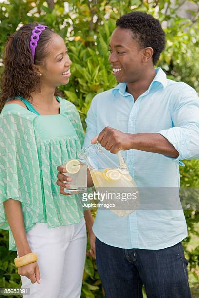 Smiling couple with lemonade