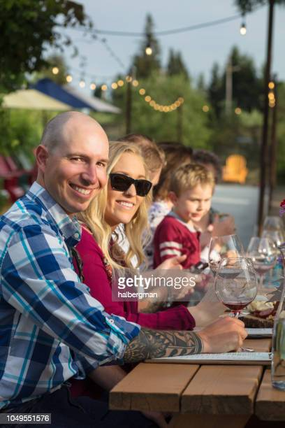 Smiling Couple with Parents and Children at Wine Tasting