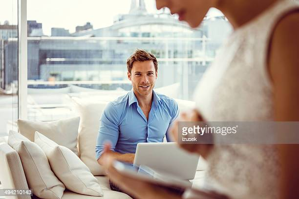 Smiling couple with technologies