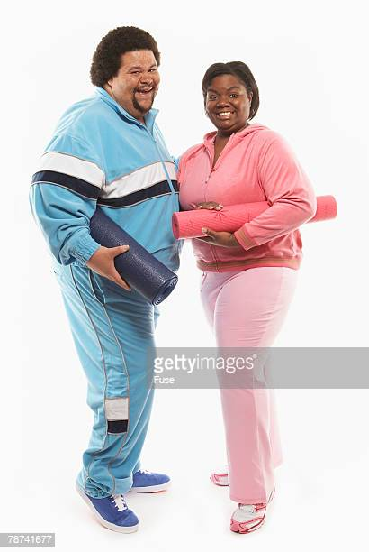Smiling Couple with Yoga Mats