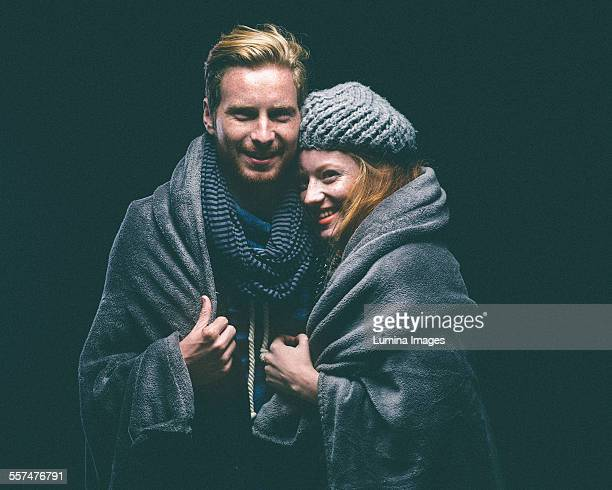 smiling couple wrapped in blanket - shawl stock pictures, royalty-free photos & images