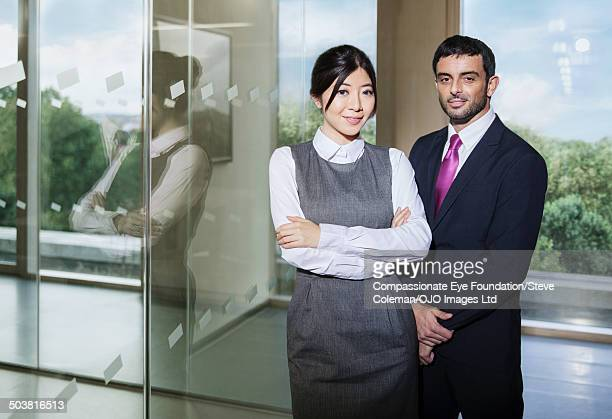 smiling coworkers in office - cef do not delete stock pictures, royalty-free photos & images