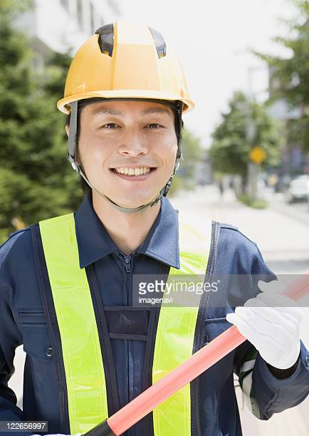A smiling crossing guard