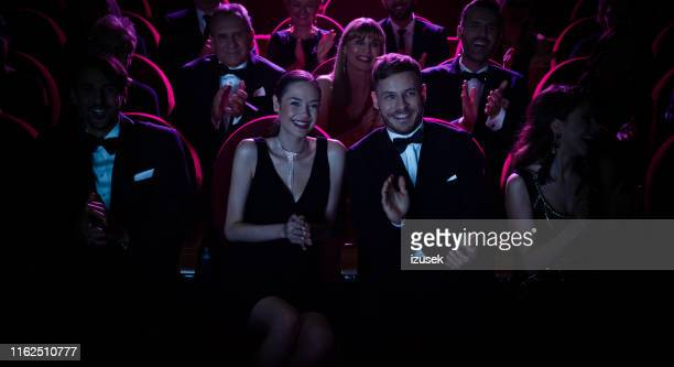 smiling crowd applauding while watching opera - white tuxedo stock pictures, royalty-free photos & images