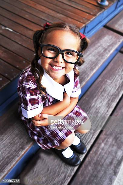 smiling cute geeky girl - girl nerd hairstyles stock photos and pictures