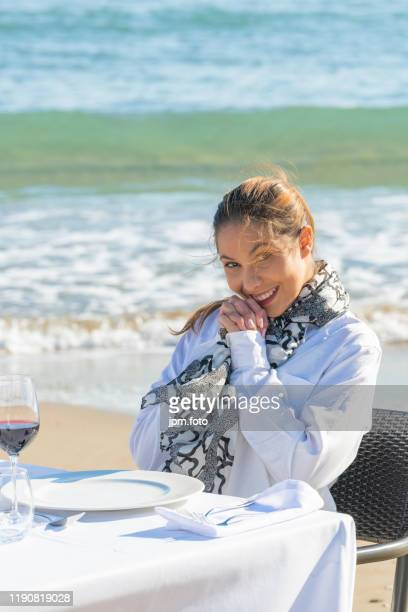 beautiful woman with sea background out