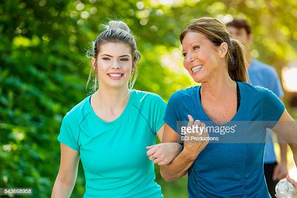 Smiling daughter and her senior mom on a walk together