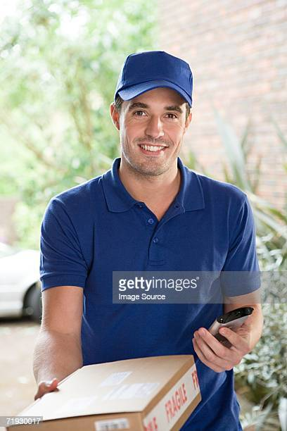 smiling delivery man - delivery person stock pictures, royalty-free photos & images