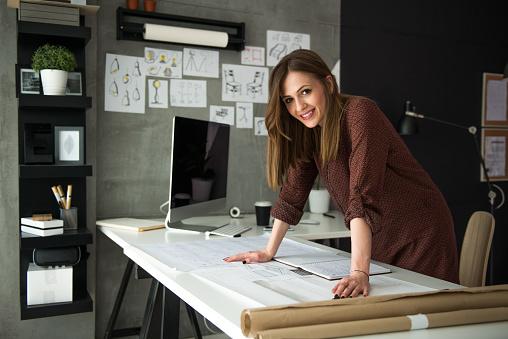 Smiling designer in her studio 948590962