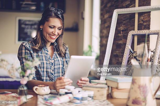 smiling designer working at home - sending stock photos and pictures