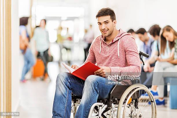Smiling disabled student in the hall.