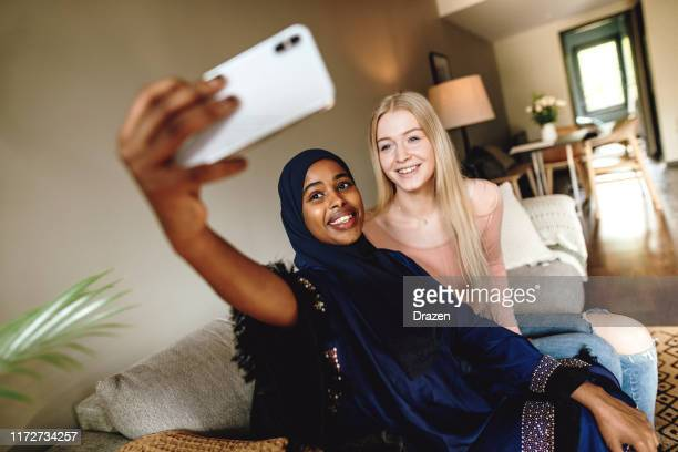 smiling diverse youth taking selfie for social media stories - religion stock pictures, royalty-free photos & images