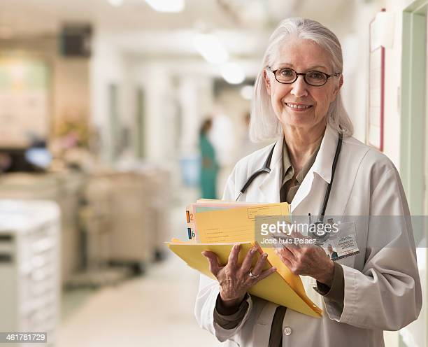 smiling doctor reviewing patients records