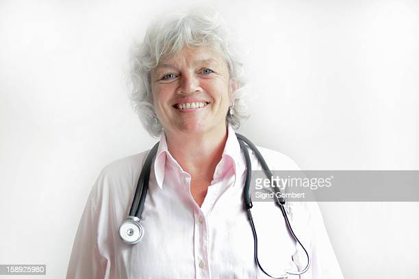 smiling doctor wearing stethoscope - sigrid gombert stock pictures, royalty-free photos & images
