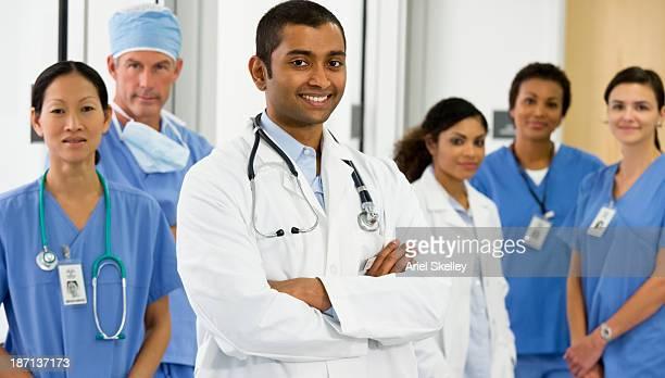 Smiling doctors talking together