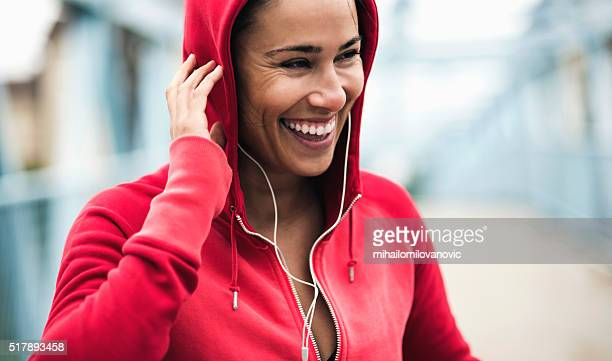 smiling during workout - hood clothing stock photos and pictures