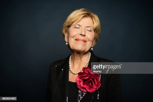 smiling elderly woman with eyes closed - evening wear stock pictures, royalty-free photos & images