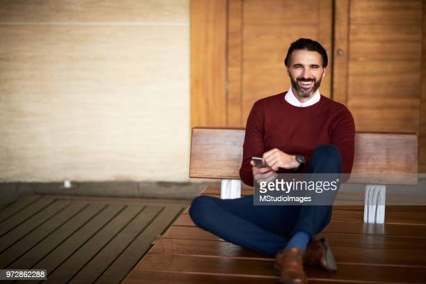 smiling elegant man looking et camera - handsome mexican men stock pictures, royalty-free photos & images